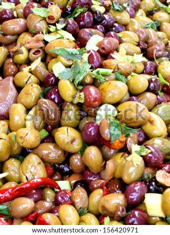 tasty olives salad dress on sale at vegetable market - stock photo