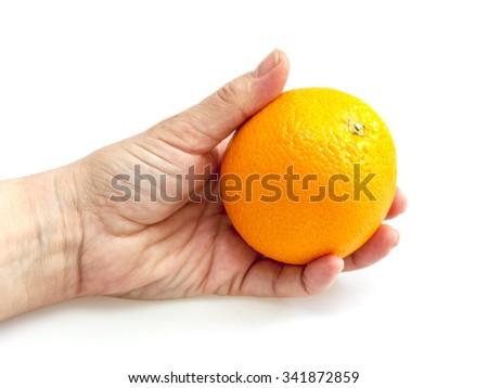 Tasty orange in a hand - stock photo