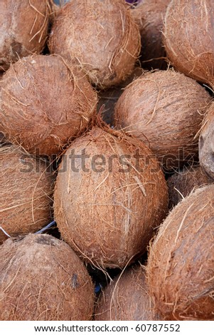 Tasty organic coconuts at local market - stock photo