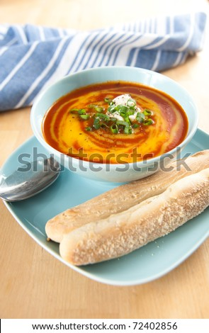 Tasty Organic Tomato Soup with Swirls of Bright Yellow Butter squash Soup