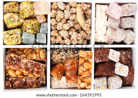 Tasty oriental sweets in wooden crate, isolated on white - stock photo
