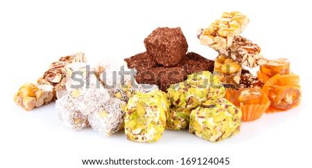 Tasty oriental sweets (Turkish delight), isolated on white - stock photo