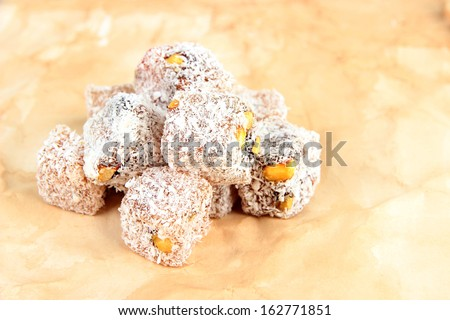 Tasty oriental sweets (Turkish delight), on brown background - stock photo