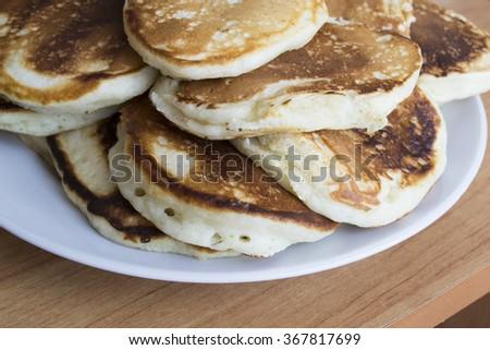 Tasty pancakes on a white plate  - stock photo