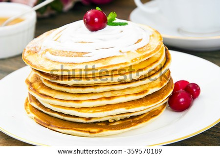 Tasty Pancakes with Cranberry Stack Studio Photo