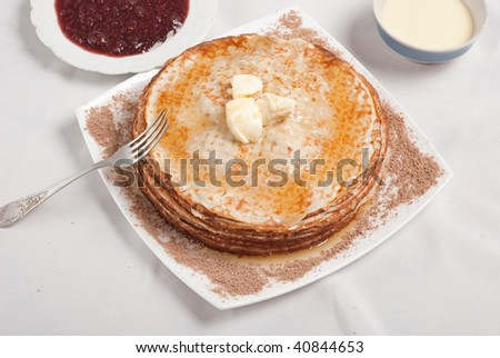 Tasty pancakes with jam, and honey