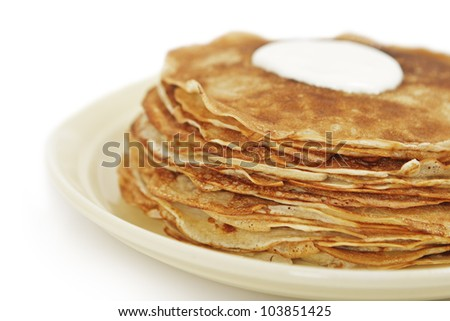 Tasty pancakes with sour cream from above. Side view. - stock photo