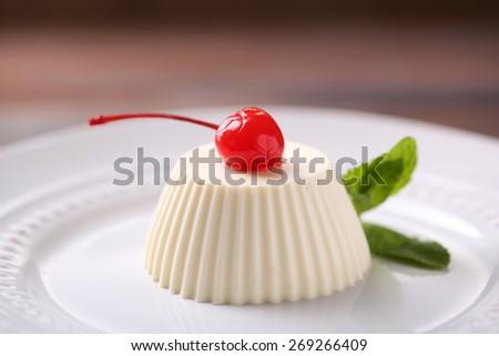 Tasty panna cotta dessert on plate, close up  - stock photo