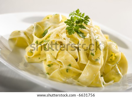 tasty pasta with cream, cheese and parsley close up - stock photo
