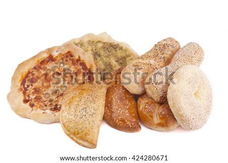 Tasty pastry assortment isolated on white background - stock photo