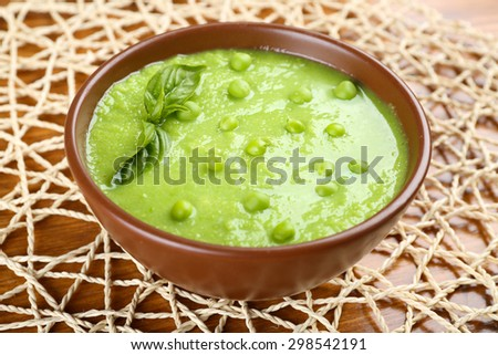 Tasty peas soup on table close up - stock photo