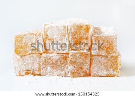 Tasty pieces of orange turkish delight isolated on white - stock photo