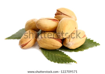 tasty pistachio nuts with leaves, isolated on white - stock photo