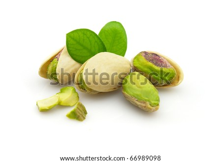 Tasty pistachio with leaves on a white background