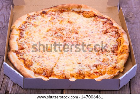 Tasty pizza in  a box - stock photo