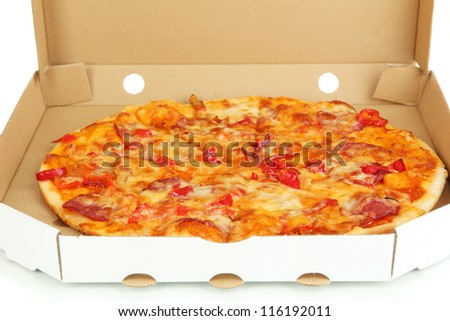 Tasty pizza in box close-up - stock photo