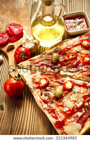 Tasty pizza on table - stock photo