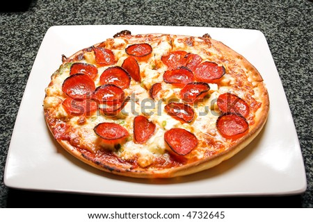 Tasty Pizza served in a plate and enjoyed by friends - stock photo