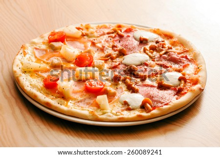 tasty pizza with pineapple - stock photo