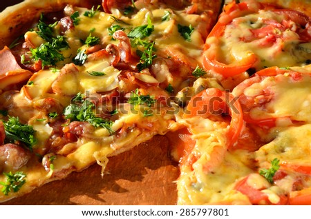 Tasty pizza with sausage and vegetables, macro view - stock photo