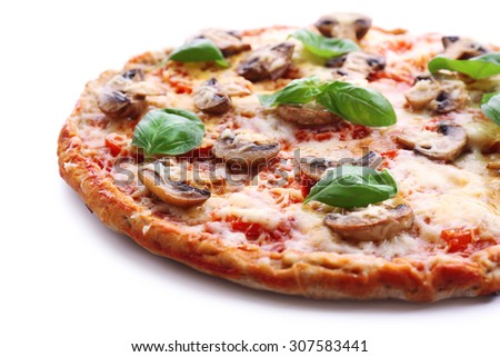 Tasty pizza with vegetables and basil close up