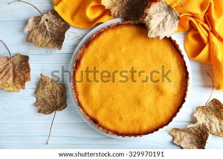 Tasty pumpkin pie on a blue wooden table - stock photo