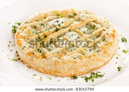 tasty quiche with cheese and herbs - stock photo