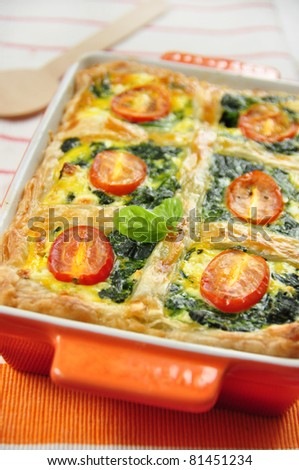 tasty quiche with spinach and tomato, spanakopita - stock photo