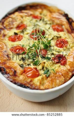 tasty quiche with tomato and zucchini - stock photo