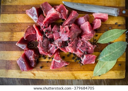 Tasty raw fresh juicy meat and knife - stock photo
