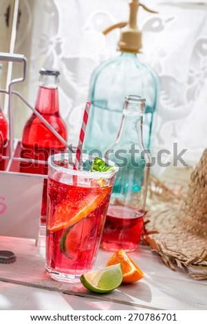 Tasty red orangeade with mint leaf - stock photo