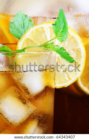 Tasty, refreshing ice tea, with lemon.  Macro - stock photo