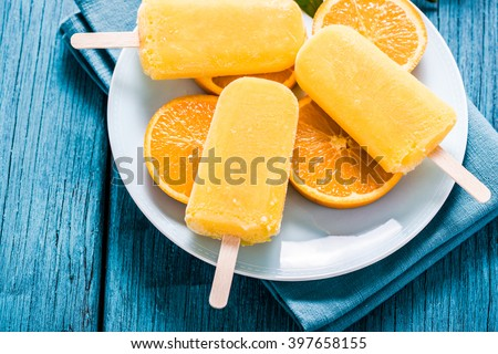 tasty refreshing summer treat, popsicle with natural juice - stock photo
