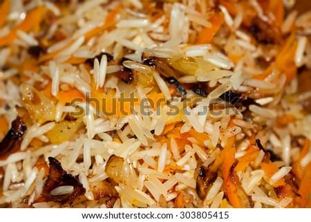 Tasty rice preparing in wok - stock photo