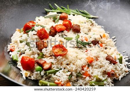 Tasty rice preparing in wok, close-up - stock photo