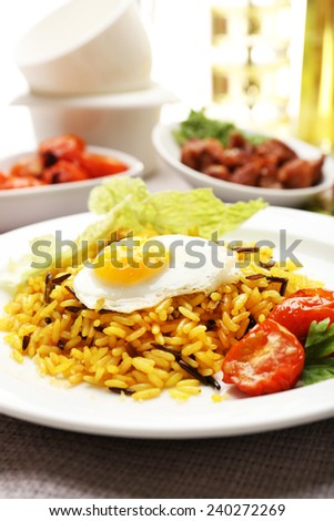Tasty rice served on table, close-up - stock photo