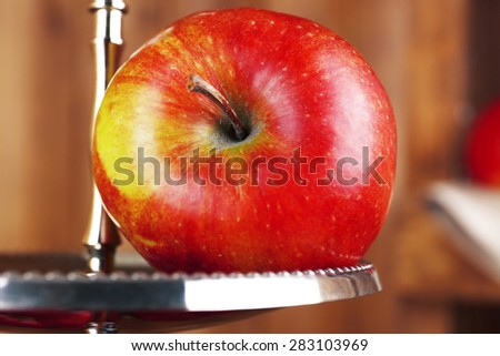 Tasty ripe apple on serving tray close up - stock photo