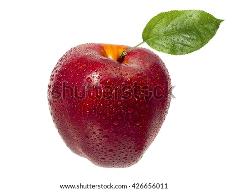 Tasty, ripe, red, juicy apple in drops of water with a green leaf on a white background. - stock photo