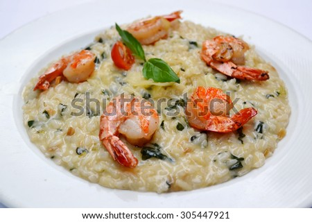 Tasty risotto with tiger prawns and special Arborio rice - stock photo