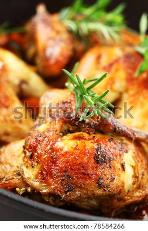 Tasty roasted chicken with vegetable and herbs - stock photo
