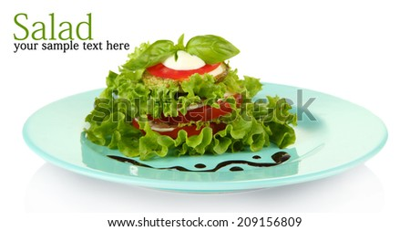 Tasty roasted marrow and tomato slices with salad leaves, isolated on white - stock photo
