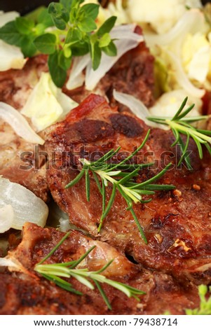 Tasty roasted pork meat with cabbage and vegetable - stock photo