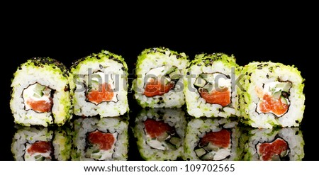 Tasty rolls isolated on black - stock photo