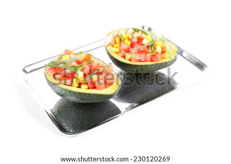 Tasty salad in avocado on tray isolated on white
