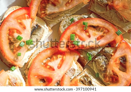 Tasty sandwich from with sprats and tomato
