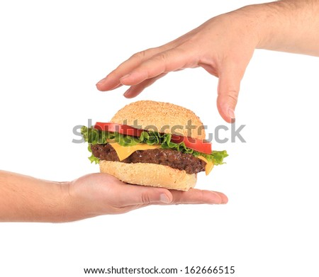 Tasty sandwich in hands. Isolated on a white background. - stock photo
