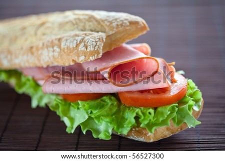 tasty sandwich of ham lettuce and tomato - stock photo