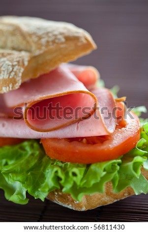 tasty sandwich of ham lettuce and tomato - stock photo