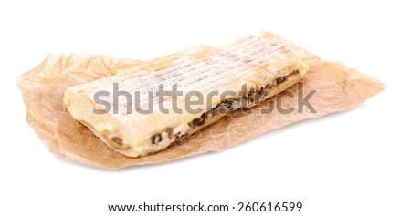 Tasty sandwich on paper isolated on white - stock photo
