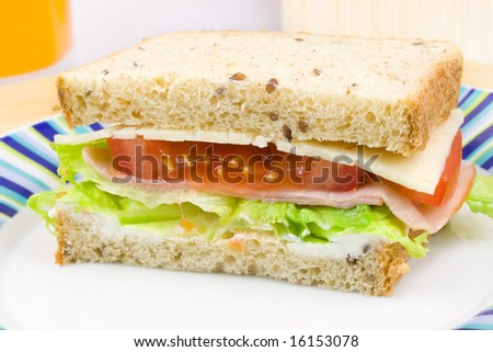 Tasty sandwich on plate with stripes - stock photo